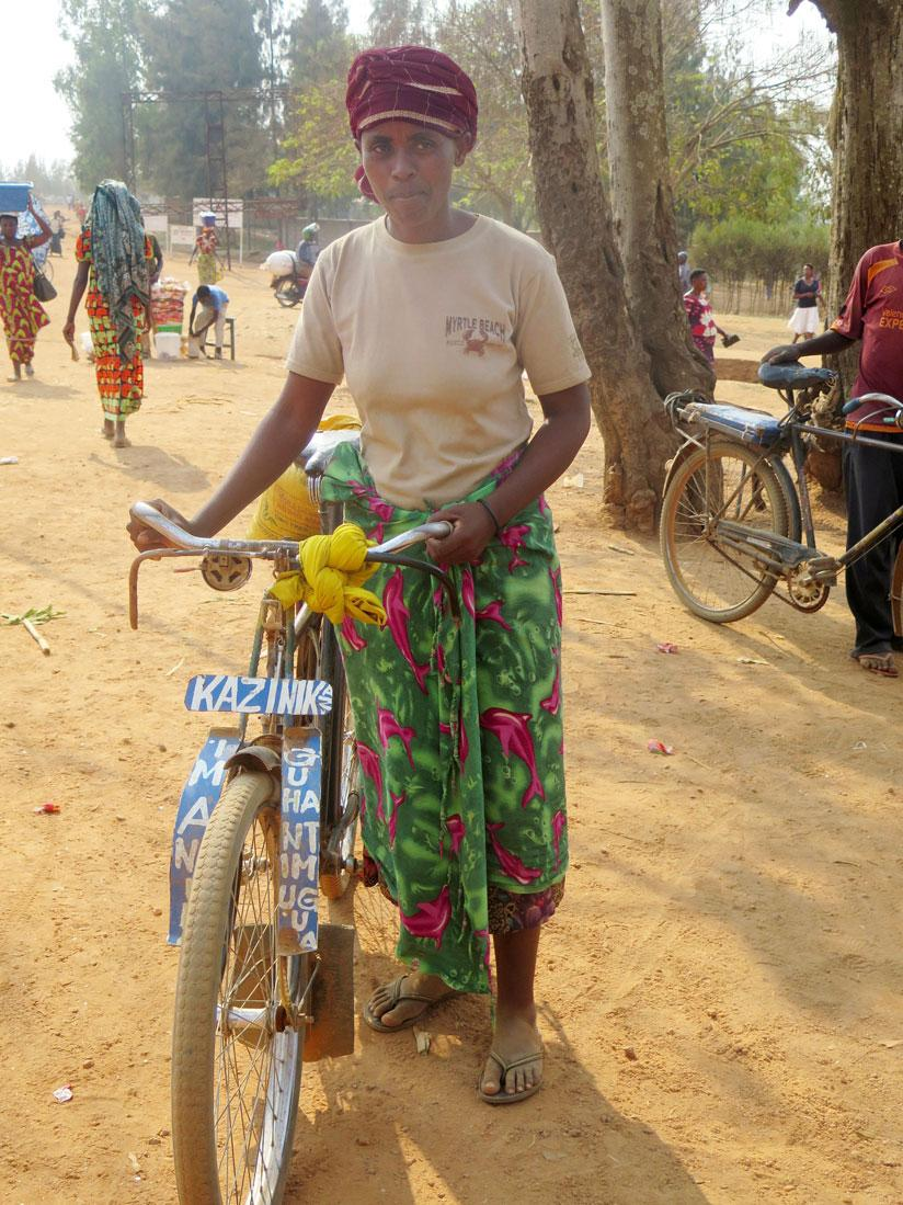 1471557145Kindama-Cell-resident,-the-33-year-old-Bonifilde-Nyiracumi-coming-from-Ruhuha-market-by-her-bicycle