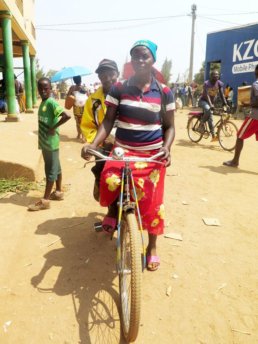 1471557225From-Nyanza-district,-the-22-year-old-Gaudence-Nirere-taking-her-father-Antoine-Kaberuka-to-Ruhuha-Market