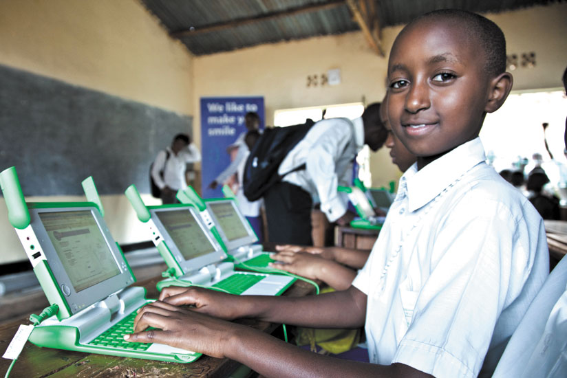 A pupil of Kimisagara Primary School uses a laptop during class. The new app will help parents keep track of their children while at school. / File