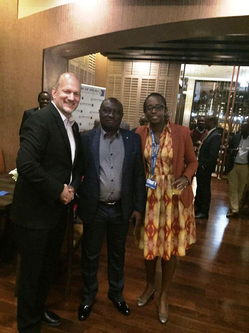 Marriott's Kenneth Shore and BK's Diane Karusisi with the customer (center) that won a night at the Marriott hotel. / Courtesy