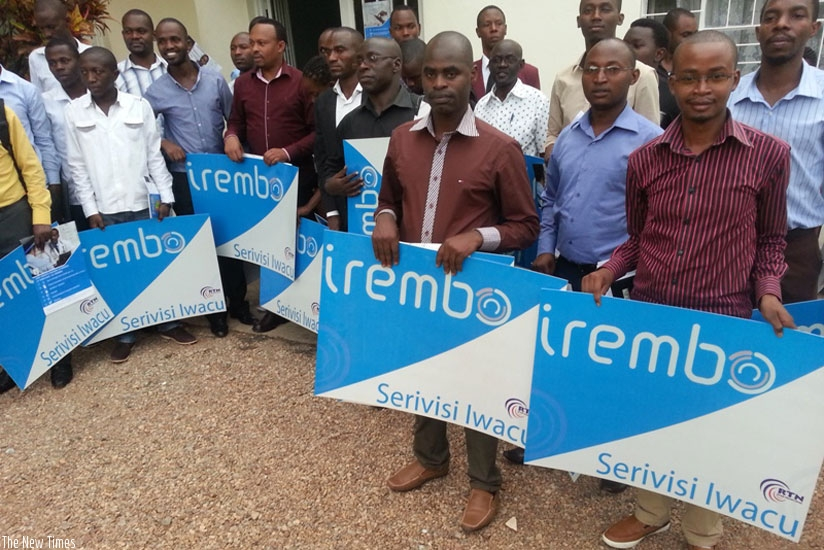 """Telecentre managers pose for a group photo upon completion of training in """"Irembo platform""""  (File)"""