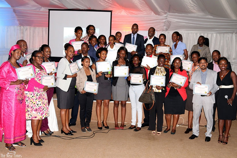 The writer (extreme right) poses with some of workers and managers who were awarded for excellence customer service last year. (Courtesy photo.)