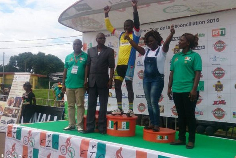 Gasore Hategeka on podium after winning stage 3 on Monday. (courtesy)