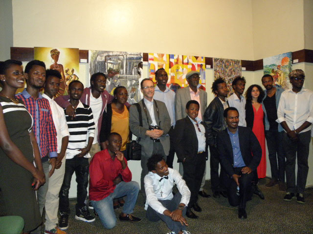 Local artists pose with the French filmmaker David Helft (centre in a suit) at the premiere of the 'In the Eye of the Artist' documentary. / Donata Kiiza.