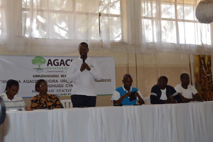 1474929858Agaciro-Development-Fund-CEO,-Jack-Kayonga-(in-standing-position)-speaking-at-the-event