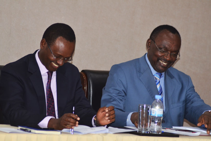 Minister Kanimba (R) and Trade and Industry ministry permanent secretary Emmanuel Hategeka share a light moment during the launch of the National Trade Committee in Kigali yesterda....