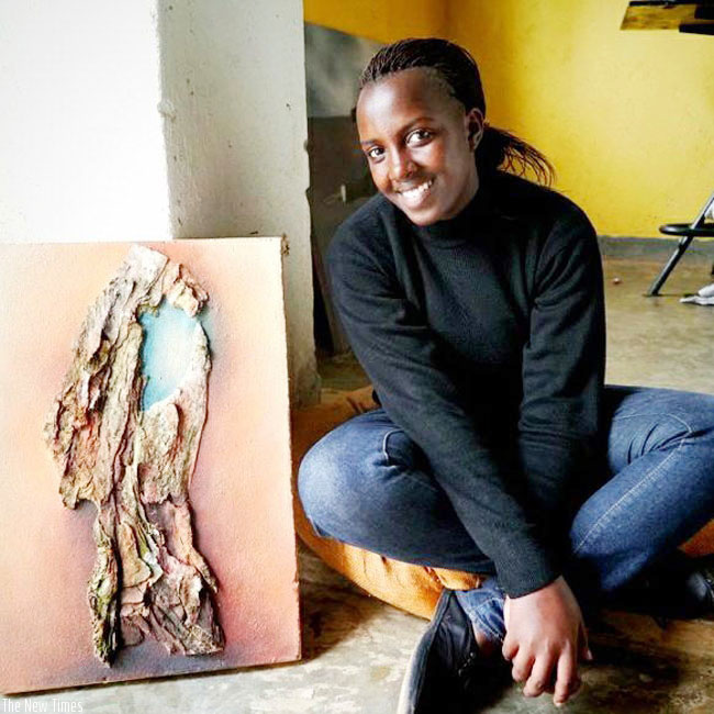 Hortance Kamikazi poses with one of her art pieces. / Courtesy