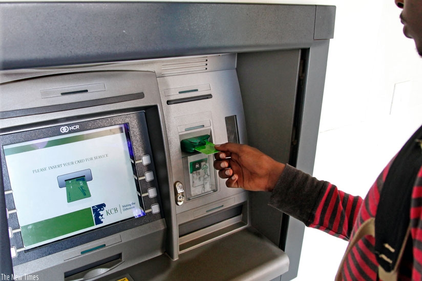 A bank client uses an automated teller machine. Banks are yet fully take advantage of opportunities offered by ICTs. (File photo)