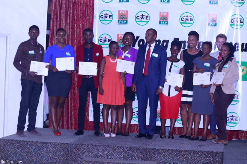 Some of the youths that pitched business ideas during the contest show off their certificates. Three youths with top ideas bagged a total of Rwf450,000 in start-up capital. (Photos....