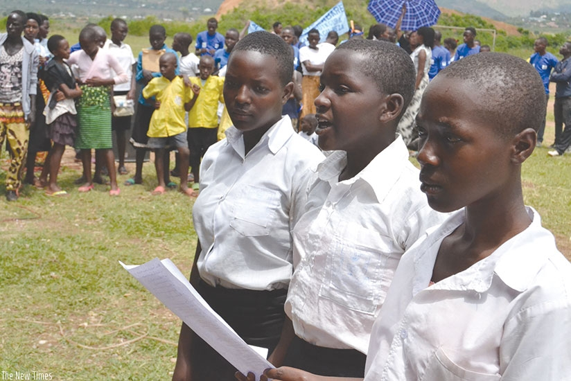 Girls recite a poem during the International Day of the Girl Child celebrations in Kayonza District on Friday. / Stephen Rwembeho.