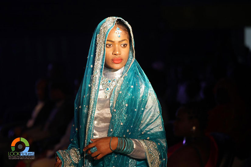 A model wears fashionable traditional Indian attire - one of the designs showcased at the Saturday fashion show. / Courtesy