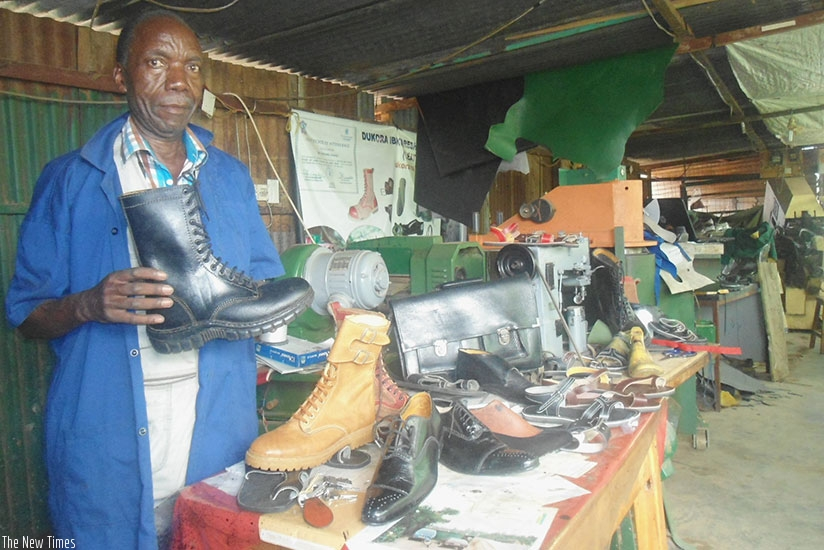 Juvenal Gatorano, the proprietor of Nyamirambo-based Atelier de Gatorano, which makes leather products, at his workshop. The expos enable people, like Gatorano, to penetrate other markets. (Remy Niyingize.)