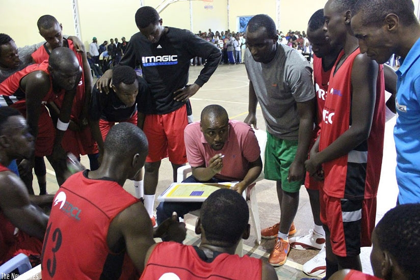 REG coach Bahufite talks to his players during time out in the game against IPRC-Kigali on-Saturday, last week. (File)