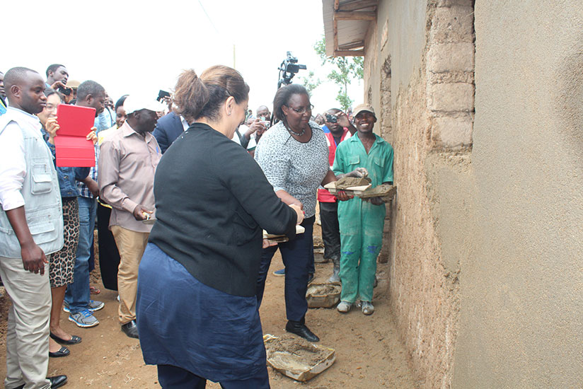 Seraphine Mukantabana, the minister for Disaster Management and Refugees Affairs, and Mehrnaz Mostafavi, the head of Human Security Unit at the UN headquarters joined the community to set a new model village. / Frederic Byumvuhore