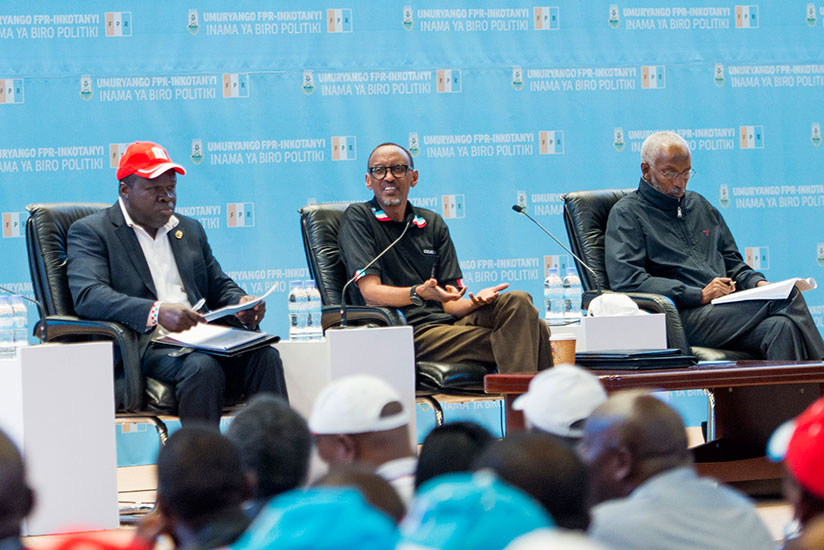 President Kagame, flanked by RPF Vice Chairman Christophe Bazivamo (L) and the party's Secretary-General Francois Ngarambe, speaks at the RPF Political Bureau meeting at Kigali Convention Centre yesterday. / Village Urugwiro