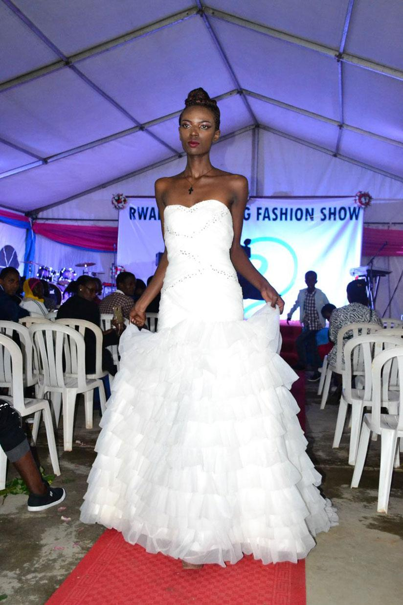 Photos trendy gowns at rwanda wedding fashion show the new times models cut a wedding cake at the event junglespirit Choice Image