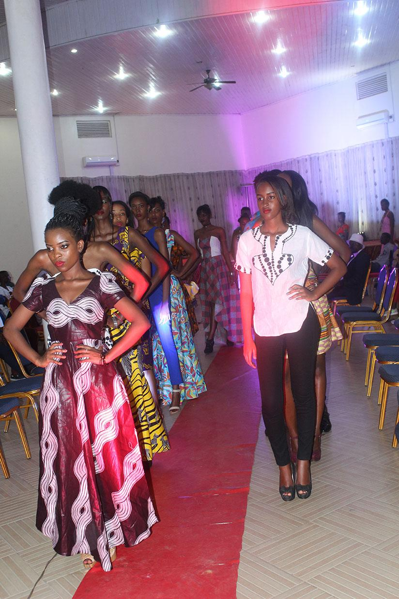 Models present some of the creations from designers who took part in the Invention Fashion show, at Sports View hotel. / Donata Kiiza