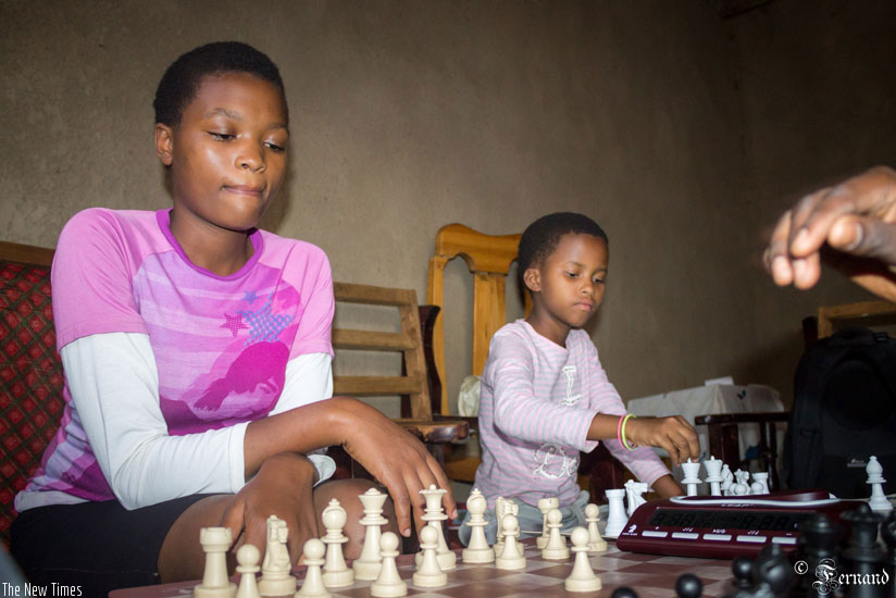 1482782265Rising-chess-star-Sandrine-Uwase-(R)-missed-the-chance-to-play-at-the-2016-Chess-Olympiad-in-Baku,-Azerbaijan-in-September