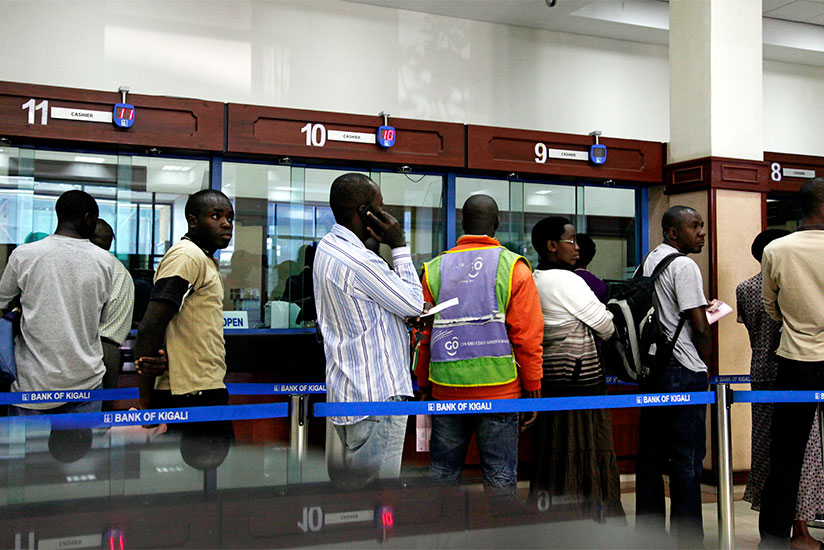 Bank of Kigali clients queue to get served. / File