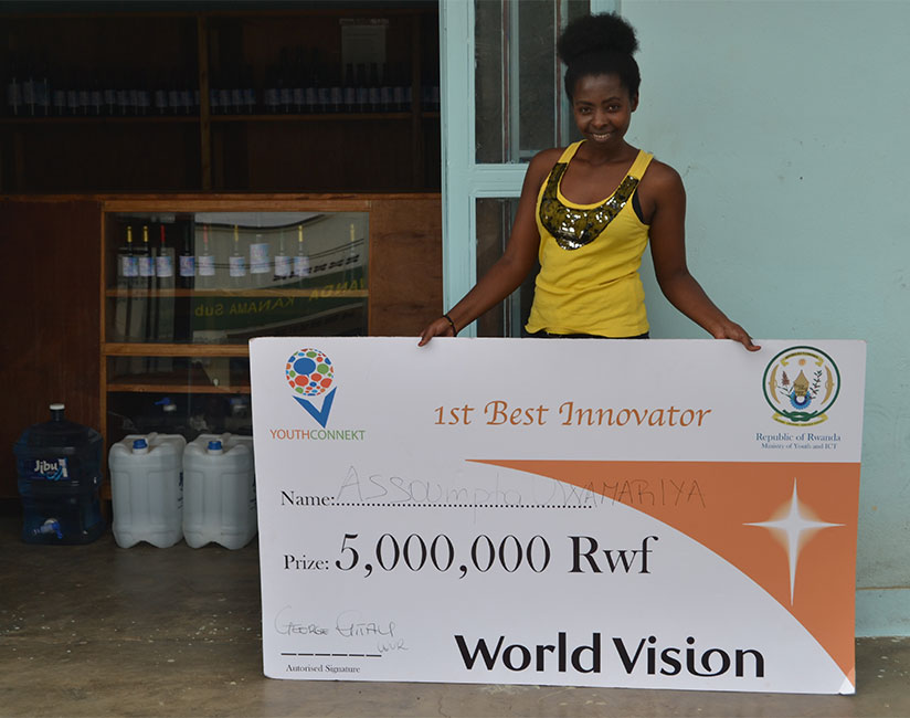 1486077663Assoumpta-Uwamariya-showig-her-Rwf5-million-award-dummy-check-as-first-best-innovator-of-YouthConnekt-innovator-award,-at-her-workplace-at-Mahoko--Centre-in-Rubavu-District,-on-Thursday,-January-19,-2017.-(E