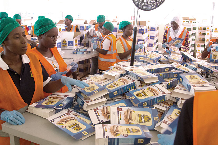 1486073118Workers-at-The-Africa-Improved-Foods-–-factory-based-at-Kigali-Special-Economic-Zone-Nyandungu,-assemble-boxes-to-pack-in-the-produce