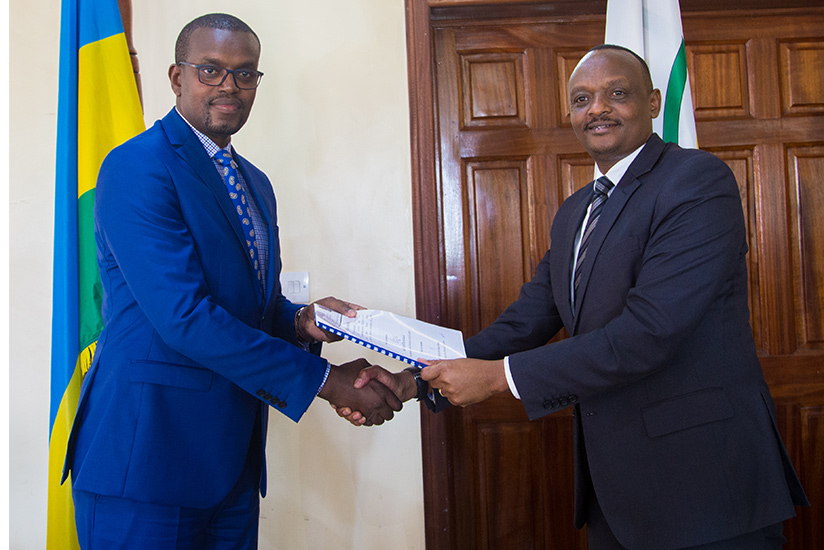 1487023743Outgoing-Richard-Muhumuza-(R)-hands-over-to-Jean-Bosco-Mutangana-as-the-new-Prosecutor-General.-Muhumuza-was-appointed-by-the-cabinet-to-the-position-of-Supreme-Court-judge