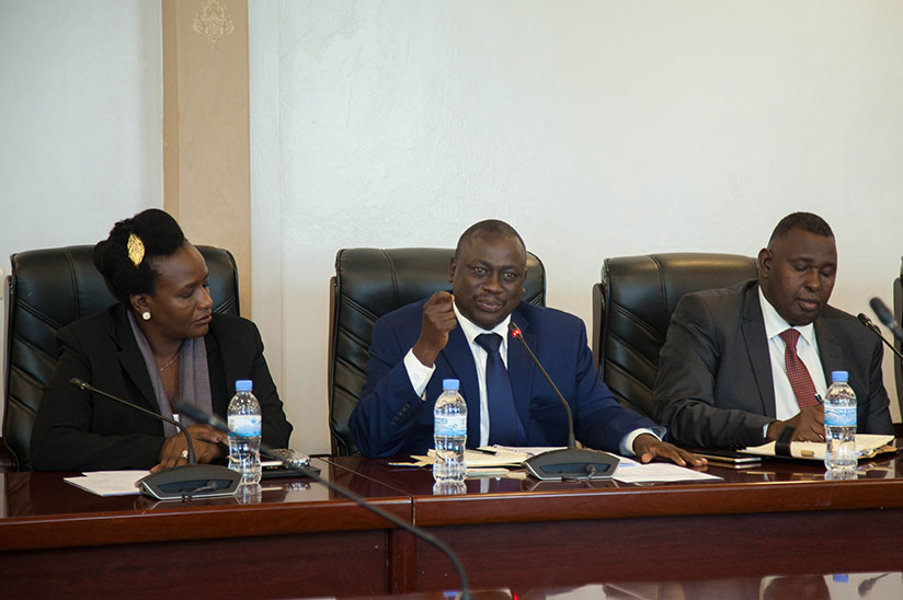 Hon. Alex Ruhunda head of Ugandan delegation (C) speaks during the meeting with MPs in parliament yesterday. Nadege Imbabazi.