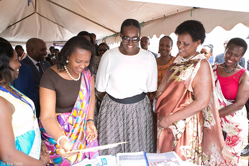 Mrs Kagame, Nyirasafari (to her right) and  Kanakuze (to her left) at Pro-Femmes Twese Hamwe's 25th anniversary celebration yesterday.