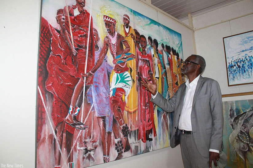 Renowned local visual artist Epa Binamungu shows off one of his paintings. (File)