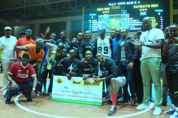 Patriots basketball club players and officials celebrate after winning this year's playoff finals against REG on Saturday evening at Amahoro Indoor Stadium. / Courtesy