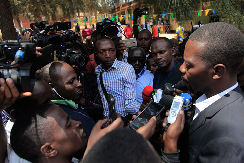 Mpayimana speaks to the press after casting his vote at Camp Kigali Primary School (Sam Ngendahimana