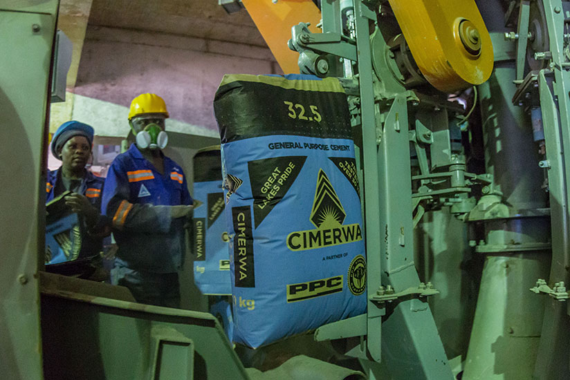 Cimerwa workers monitor a production line. Cimerwa is one of the firms that have strived to create brand visibility. /File.