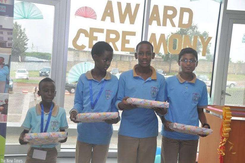 Being smart yields to success.  Pupils pose for a photo with their prizes after winning a competition. / Dennis Agaba