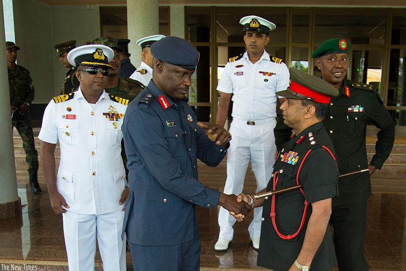Rwanda Defence Forces' Air force Chief of Staff Brig Gen Charles Karamba welcomes Col Kithsiri Ekanayake, the head of the visiting Sir Lankan military delegation, to the RDF Headqu....