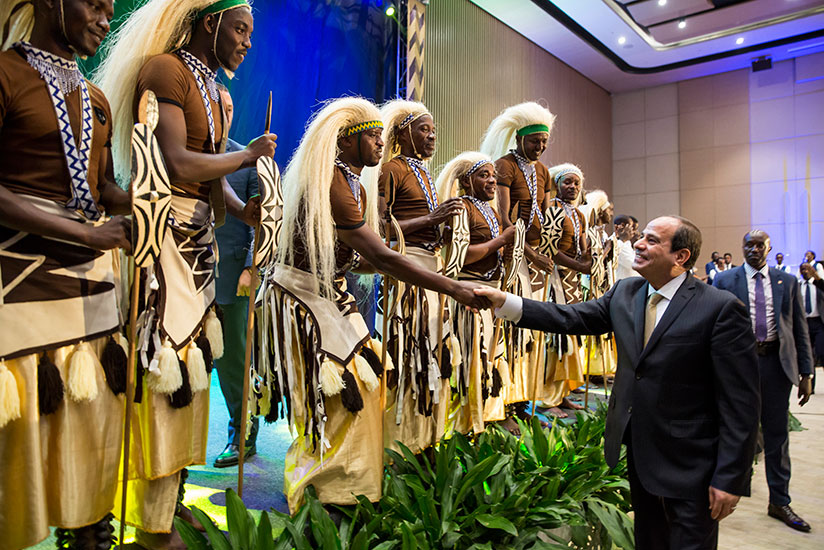 1502838769President-Sisi-greets-traditional-dancers-during-the-banquet