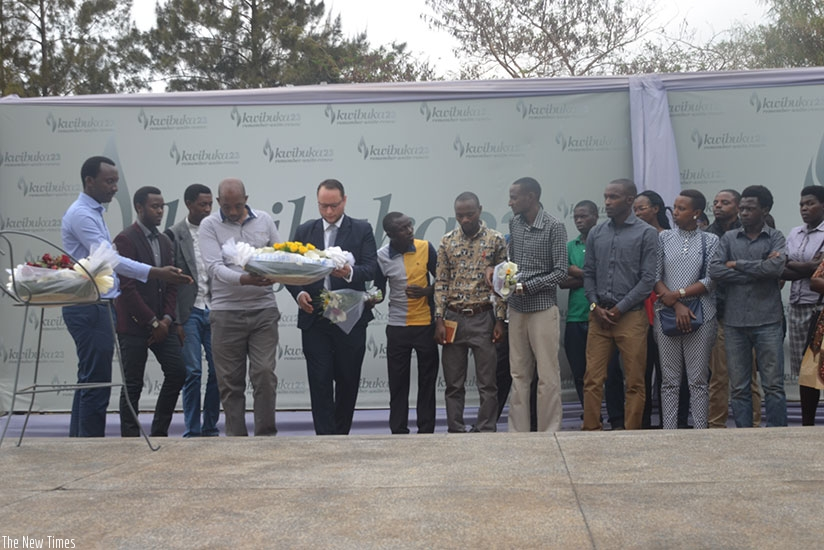 Ajeprodho staff and students  lay a wreath at the Gisozi memorial site. / Francis Byaruhanga.
