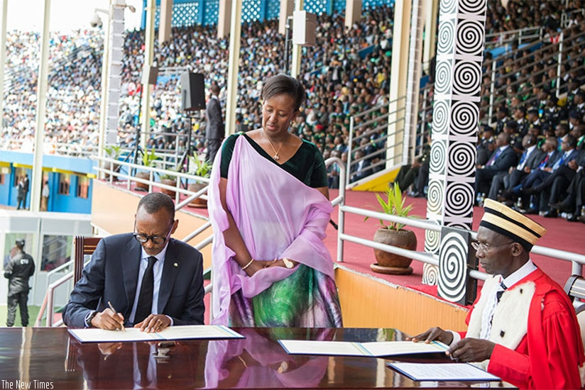President Kagame signs after taking the presidential oath in the company of First Lady Jeannette Kagame (left) at Amahoro National Stadium in the capital Kigali on Friday, August 18.