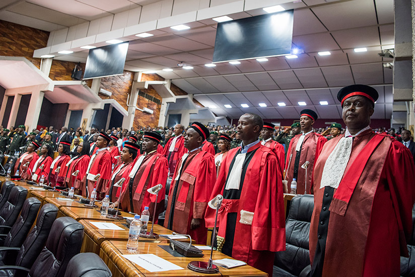 A cross section of senior judicial officers observe the National Anthem at the launch of the Judicial Year at parliament on Monday. (Courtesy)