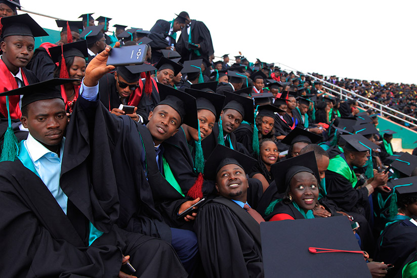 A cross-section of UR graduates share a light moment on their graduation day last month. / Sam Ngendahimana