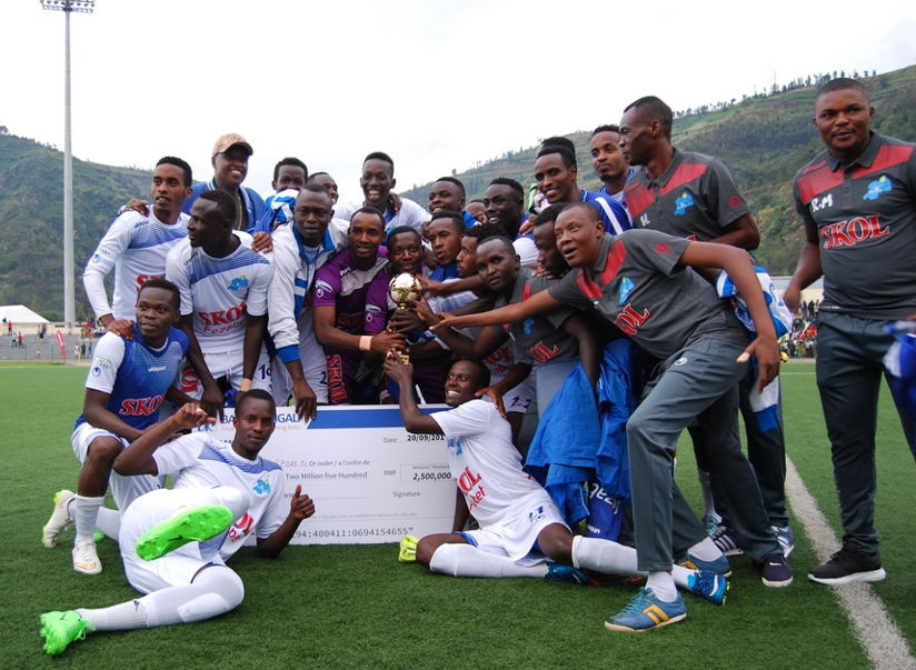 Rayon Sports players and officials celebrate after winning inaugural FEZA Cup following a 2-0 victory over Etincelles on Wednesday at Umuganda Stadium. / Courtesy