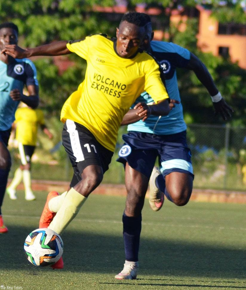 Mukura striker Yussuf Habimana tries to go past a Police FC defender during a league game last season. Mukura could pull out of the league for next season due to financial crisis. ....