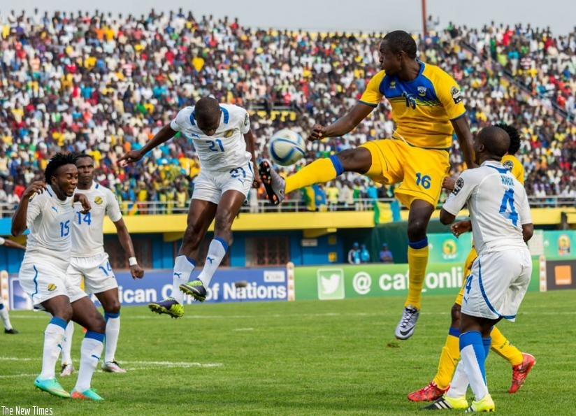 Amavubi striker Ernest Sugira (C), jumps to control the ball in a game against Gabon during last year's CHAN tournament hosted by Rwanda.  (File)