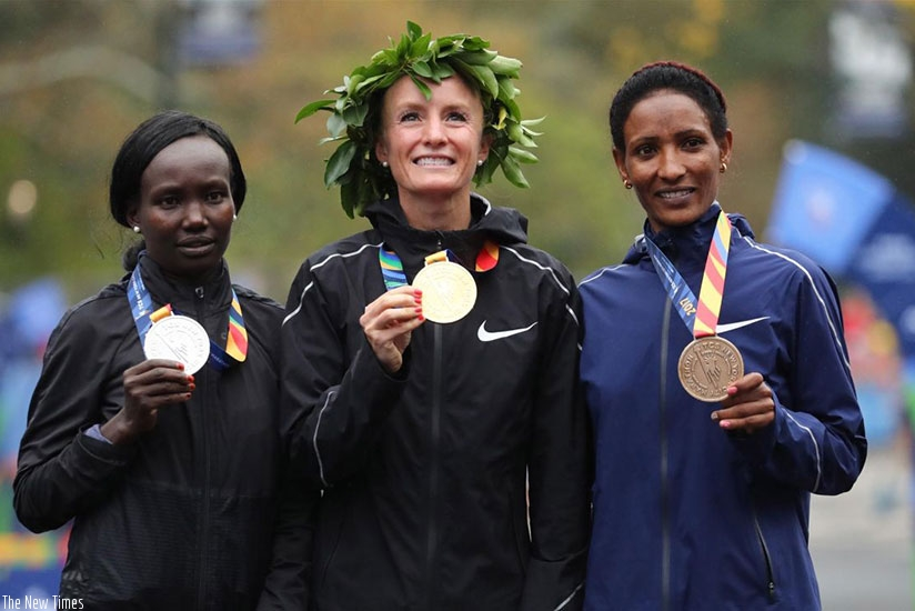 Flanagan (C) became the first American woman to win the New York City Marathon in 40 years when she claimed a dominant victory over Kenyan three-times champion Keitany (L) on Sunda....