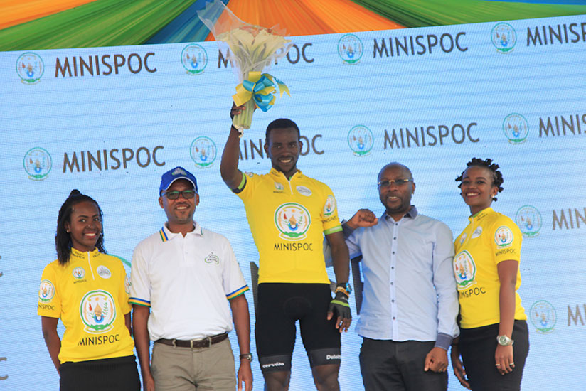 FERWACY boss Aimable Bayingana (2nd left) poses with the winner of stage one, Joseph Areruya on Monday.