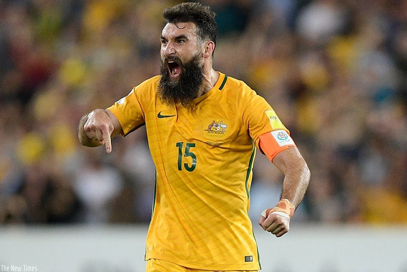 Jedinak celebrates with as much relief as passion after scoring his second goal for Australia in the do-or-die play-off match.