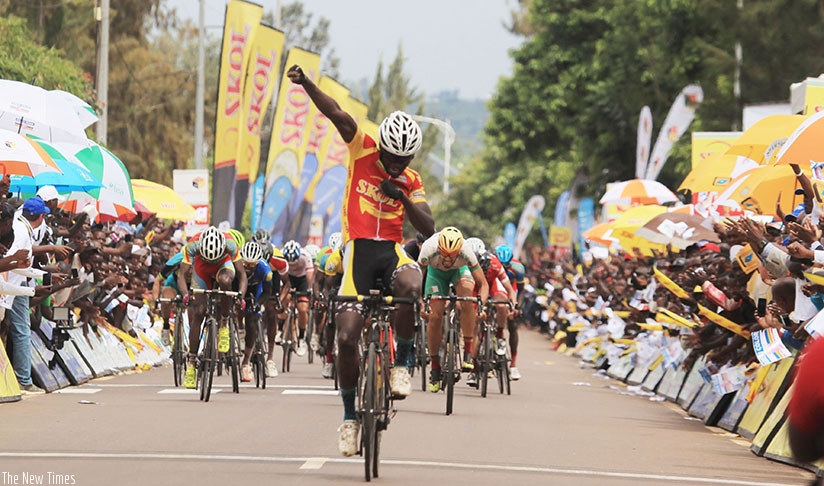 Uwizeyimana celebrates as he crosses the finish line ahead of the rest of the riders in Stage 5 of Tour du Rwanda (Sam Ngendahimana)