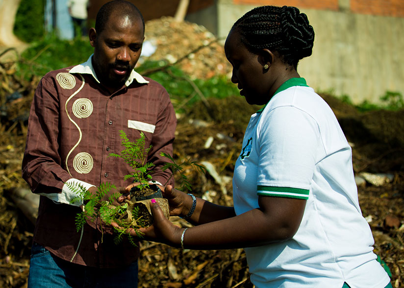 1511641647Staff-of-Kingfaisal-plant-trees-during-Umuganda