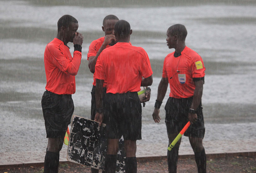 1511638788The-four-match-officials-consult-each-before-they-decided-to-call-of-the-league-match-between-Kiyovu-and-Marines-due-to-water-logged-Mumena-Stadium.-S