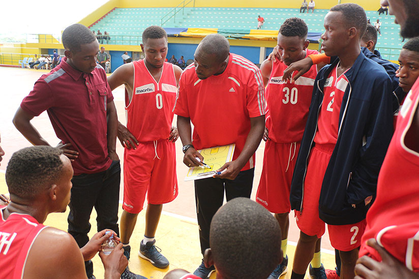 IPRC-South coach Charles Mushumba briefing players during time-out on Saturday. / Courtesy