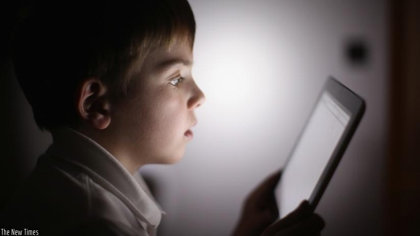 A ten-year-old boy uses an Apple iPad tablet computer on November 29, 2011 in the UK. Facebook is testing out technologies that would allow children 13 and under to use the site.